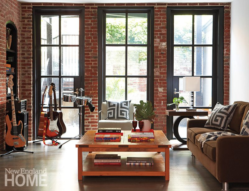 Garden level family room with exposed brick and large windows