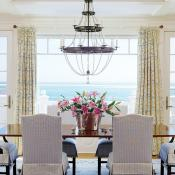 Surrounded by stately custom chairs, the dining room table by Rist is eye-catching in itself, but it pales in comparison to the view through wide windows.