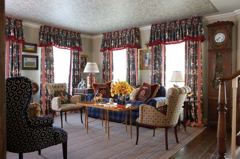 With Its Eccentric Mix Of Color And Pattern, The Living Room Conveys Cozy  Charm.