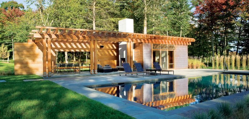 the pool house is a contemporary interpretation of the timber frame main house