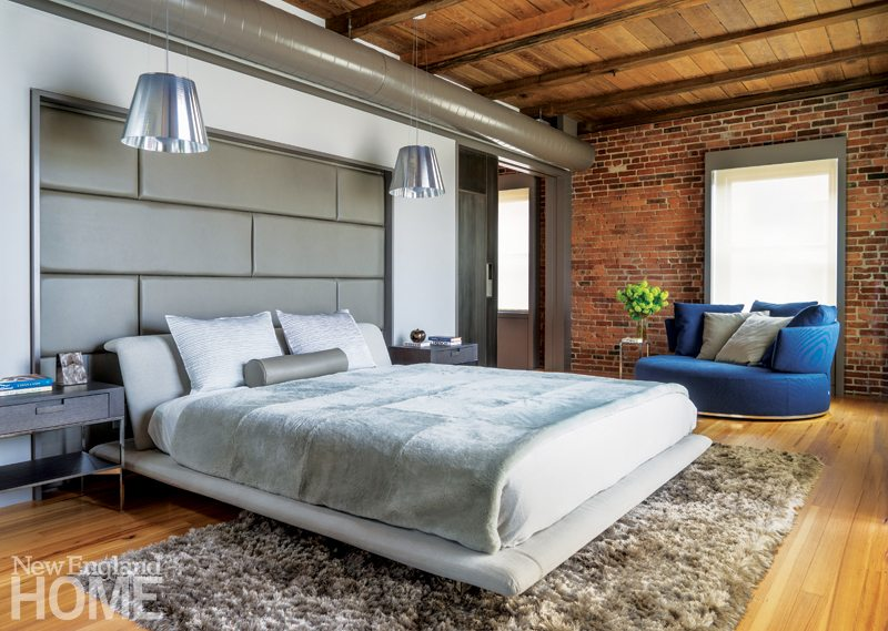 Contemporary master bedroom with leather head board