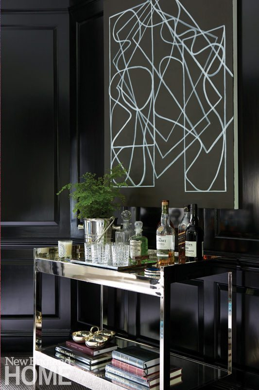 Glossy black library with bar cart
